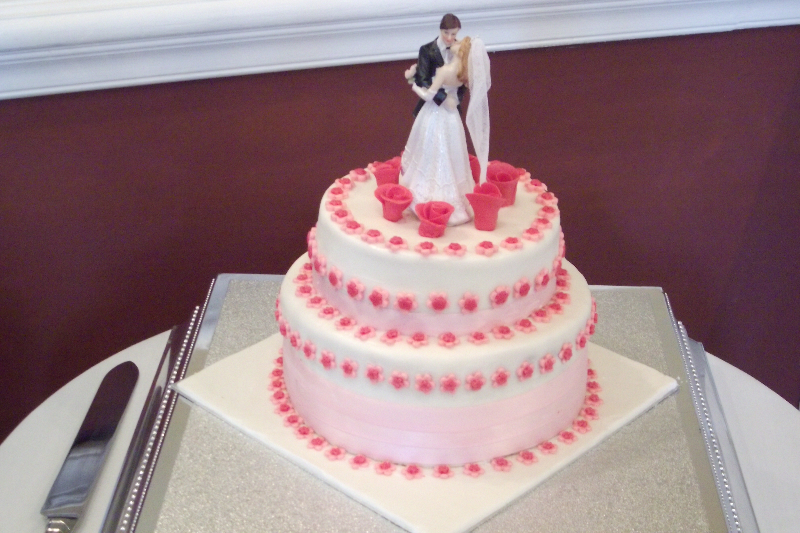 Shots of wedding cake taken by the bride and groom